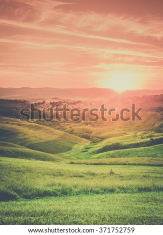 Amazing sunset over small tuscan town in Italy - stock photo