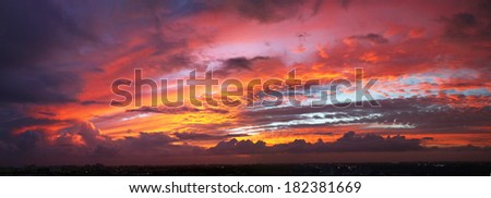 Amazing Sunset Panorama with red clouds over Miami - stock photo
