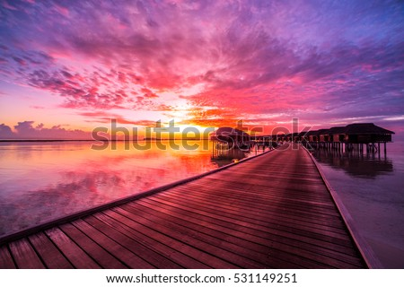 sunrise with clouds over water amazing sunset sky reflection on calm stock photo 531149251