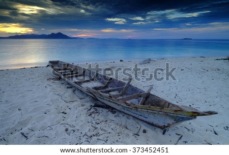 Amazing sunset with boat at the beach, borneo, malaysia.