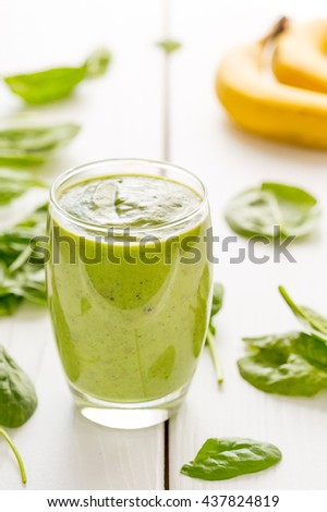 Amazing Tasty Green Avocado Shake or Smoothie, Made with Fresh Avocados, Banana, Lemon Juice and Non Dairy Coconut Milk on Light Wooden Background, Raw, Vegan Drink Conception, Vertical View - stock photo