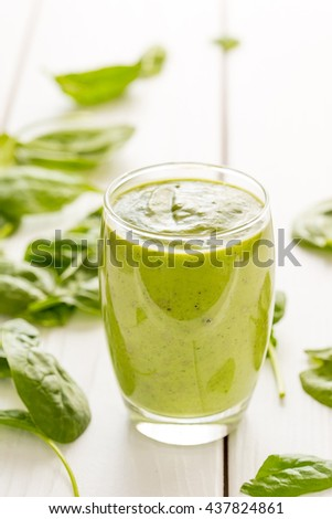 Amazing Tasty Green Avocado Shake or Smoothie, Made with Fresh Avocados, Banana, Lemon Juice and Non Dairy Milk (Almond, Coconut) on Light Wooden Background, Raw, Vegan Drink Conception, Vertical View - stock photo