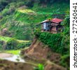 Amazing tilt shift effect view of rice terraces fields and village houses in Ifugao province mountains. Banaue, Philippines UNESCO heritage - stock photo