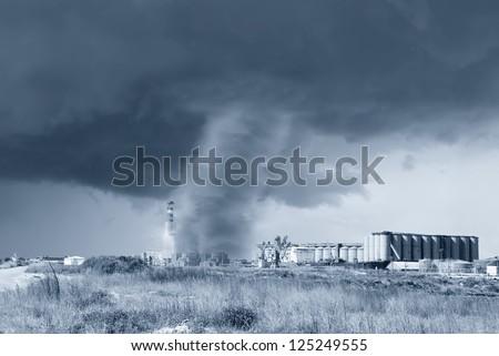 amazing tornado hits industrial plant - stock photo