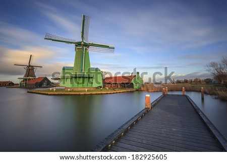 Amazing tourist destination with typical windmills. Zaanse Schans is a beautiful landscape of countryside and city. - stock photo