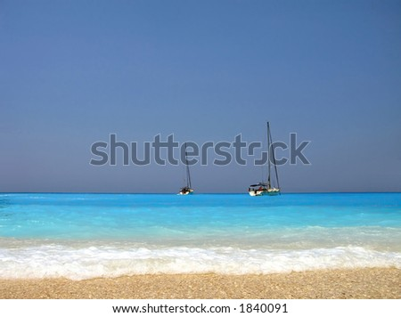 amazing turquoise beach and sail boats in Greece - stock photo