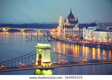 Amazing twilight with The Szechenyi Chain Bridge and Parliament in Budapest - vintage style - stock photo