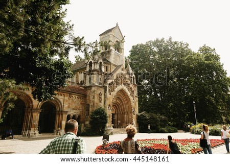 amazing  view at old gothic castle and park and tourists in the morning light in Budapest city, travel concept, space for text