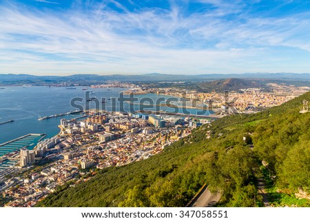 Amazing view from the top of the rock of Gibraltar on the city around it, airport and the sea before the canal. - stock photo
