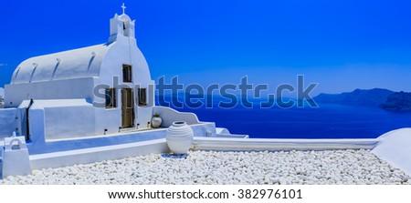 Amazing view in Oia village on Santorini island in Greece. - stock photo