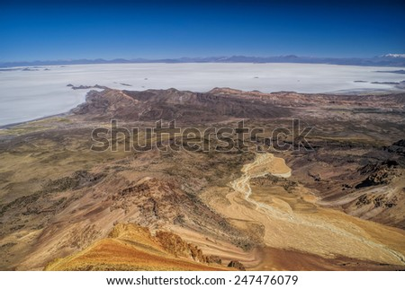 Amazing view of colored mountains and salt plane Salar de Uyuni in Bolivia - stock photo