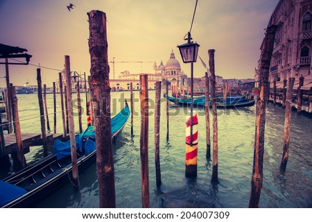 Amazing view of Grand Canal at sunset. San Marco, Venice, Italy, Europe. Beauty world. Retro style filter. Instagram toning effect. - stock photo