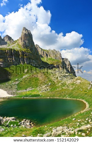 Amazing view of mountain lake Mjelsave in Albanian Alps, national park Theth, Albania - stock photo