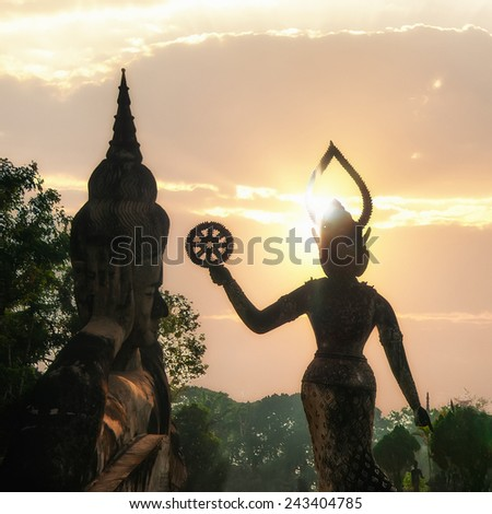 Amazing view of mythology and religious statues at Wat Xieng Khuan Buddha park at sunset. Vientiane, Laos - stock photo