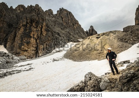 Amazing view of one of the mountain trails where there is snow even in the middle of summer, Dolomites Mountains, Italy