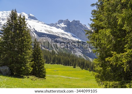 Amazing view of Swiss Alps and meadows near Oeschinensee (Oeschinen lake), on Bernese Oberland, Switzerland