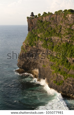 Amazing view of waves crashing the steep cliff at Uluwatu