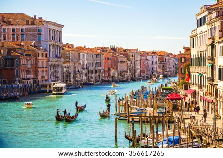 Amazing view on the beautiful Venice, Italy. Many gondolas sailing down one of the canals. - stock photo