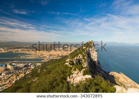 Amazing view on the top of the rock of Gibraltar and the city around it. - stock photo