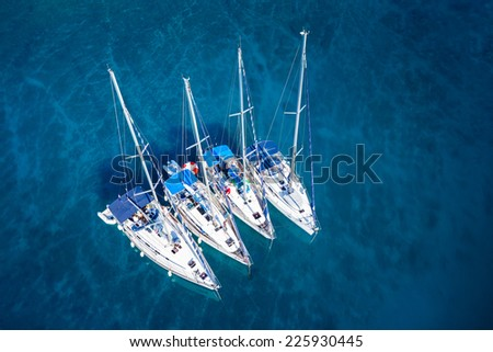 amazing view to yacht group and clear water - caribbean paradise - stock photo