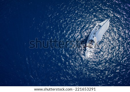 Amazing view to Yacht sailing in open sea at windy day. Drone view - birds eye angle - stock photo