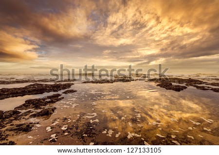 Amazing warm light and dramatic clouds at the sea - stock photo