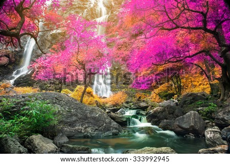Amazing waterfall in colorful autumn forest  - stock photo