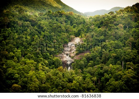 Amazing waterfall revealed through thick green jungle - stock photo