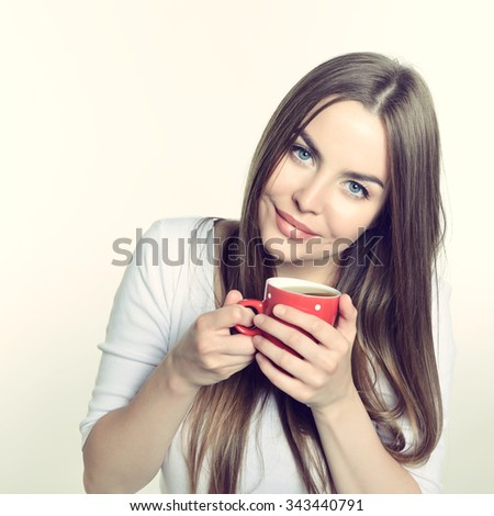 Amazing woman holding cup of tea. Perfect female beauty. Image toned.