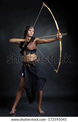 Amazon girl with the bow - stock photo