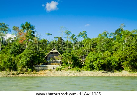 Amazon Huts with river and blue skyes - stock photo