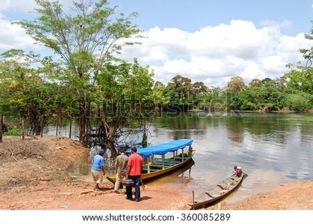 Amazon rainforest: Expedition by boat along the Amazon River near Manaus, Brazil - stock photo