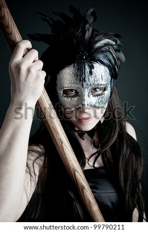 Amazon with mask and spear - stock photo