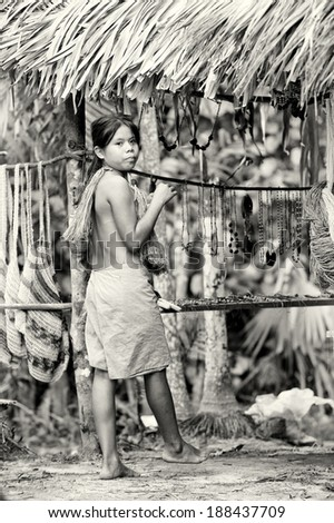 AMAZONIA, PERU - NOV 10, 2010: Unidentified Amazonian girl sells beads. Indigenous people of Amazonia are protected by COICA (Coordinator of Indigenous Organizations of the Amazon River Basin) - stock photo