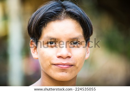 AMAZONIA, PERU - NOV 10, 2010: Unidentified Amazonian indigenous boy portrait. Indigenous people of Amazonia are protected by  COICA (Coordinator of Indigenous Organizations of the Amazon River Basin) - stock photo