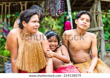 AMAZONIA, PERU - NOV 10, 2010: Unidentified Amazonian indigenous family. Indigenous people of Amazonia are protected by COICA (Coordinator of Indigenous Organizations of the Amazon River Basin) - stock photo