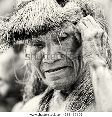 AMAZONIA, PERU - NOV 10, 2010: Unidentified Amazonian man smiles. Indigenous people of Amazonia are protected by COICA (Coordinator of Indigenous Organizations of the Amazon River Basin)