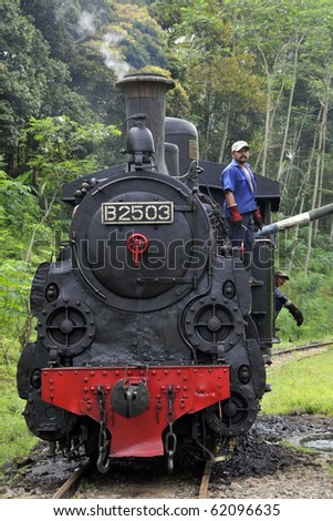 AMBARAWA, INDONESIA - JUNE 18: The only operating B2503 Steam Engine in the world was being prepared to take a group of enthusiasts to the village of Bedono. June 18, 2010 in Ambarawa, Indonesia. - stock photo