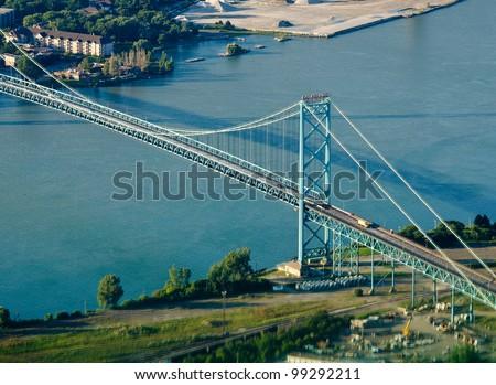 ambassador bridge connecting detroit and windsor - stock photo