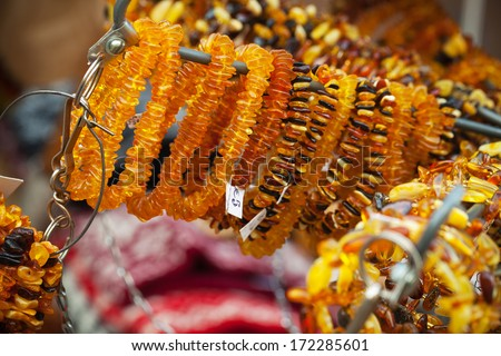 Amber beads and bracelets on the counter. Riga, Latvia. Selective focus - stock photo