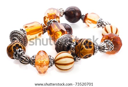 Amber bracelet with semiprecious stones and glass beads silver on a white insulated background - stock photo