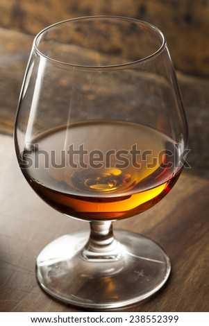Amber Brandy in a Glass Ready to Drink - stock photo