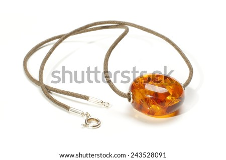 Amber charm isolated on the white background - stock photo