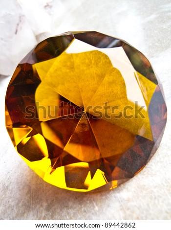 Amber coloured diamond - stock photo