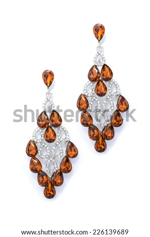 amber earrings on a white background - stock photo
