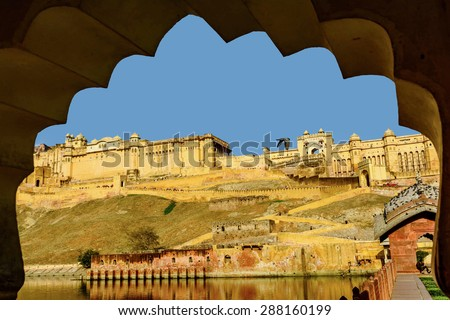 Amber Fort near Jaipur city in India seen through the arch. Rajasthan - stock photo