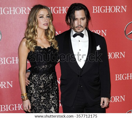 Amber Heard and Johnny Depp at the 27th Annual Palm Springs International Film Festival Awards Gala held at the Palm Springs Convention Center in Palm Springs, USA on January 2, 2016. - stock photo