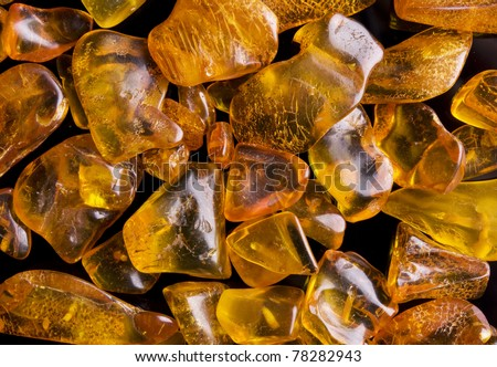 Amber isolated on black background - stock photo