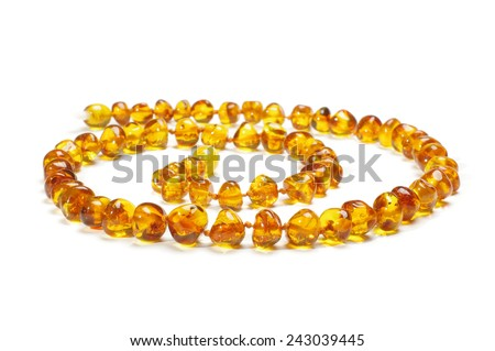Amber necklace in spiral isolated on the white background - stock photo