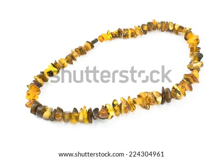 Amber necklace isolated on white